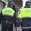 Dos agents de la policia local, a l'Alameda/PL
